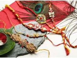 5 Fancy Rakhis  1 Pooja Coin   Greeting Card